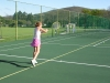 Marli le Roux (lefty) hits a high back hand