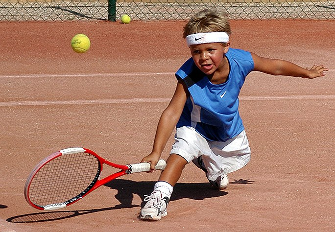 boy-playing-tennis